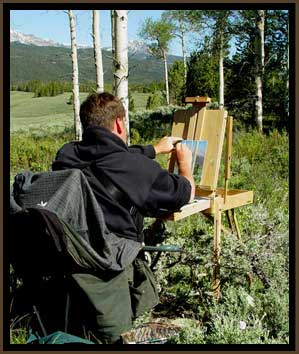 Photo of TJ painting outdoors in Wyoming